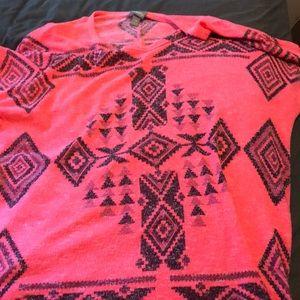 Pink three-quarter length shirt with black design